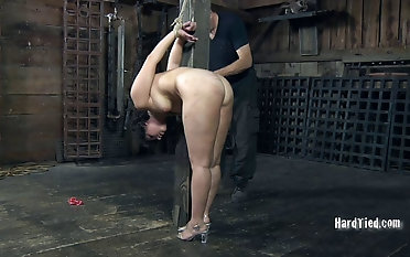 Attractive brown-haired dame wails in a naughty tormented restrain slavery sequence