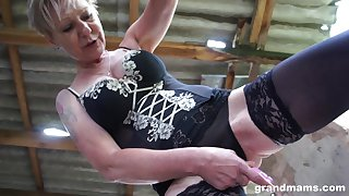 Dressed round sexy stuff mature grumble teases her own age-old pussy well