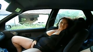 This busty mature woman wants me to play close to her pussy in my wheels